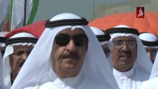 صاحب السمو الشيخ سعود بن راشد المعلا يرفع علم الامارات احتفالا بيوم العلم