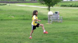 My U9 Girl juggling and toying with her soccer ball (her juggling record is 6114 feet only!)