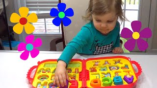 Genevieve Helps Teach Kids their ABC