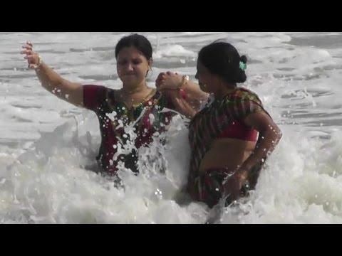 Beautiful Tourist enjoying sea baths in Digha Sea Beach