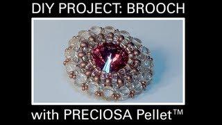 A brooch made with PRECIOSA Pellet™