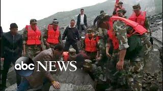Desperate search for landslide survivors in China