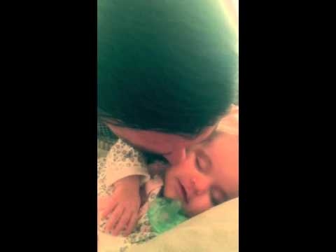 Sleeping daughter's love for dad's kisses