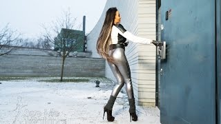 High heeled boots and silver leggings