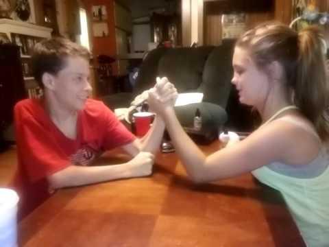 Arm Wrestling 12 yr old girl beats 2 boys