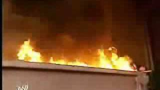 Shane McMahon kicks Kane into burning dumpster
