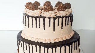 Ferrero Rocher Chocolate Drip Cake decorated with whipped cream