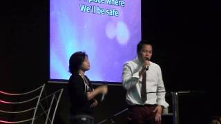 Pastor Luis and Liezel singing