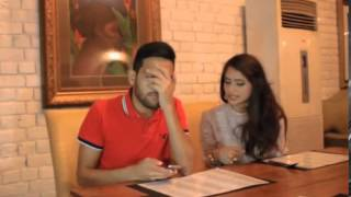very funny indian couple in restaurant