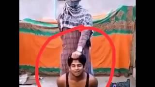 ISIS GIRL GANGSTER CUTTING A BOY HEAD