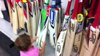 My kids checking out cricket bats at Rebel Sports.