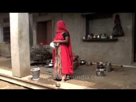 Women cook wearing ghungat or veils : Rajasthani village of Sonkhaliya