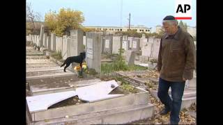 Officials say 200 graves, 100 monuments vandalised at Jewish cemetery