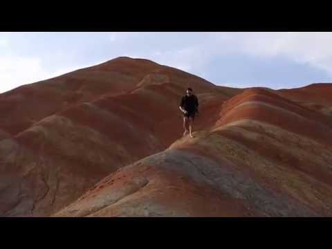 Sedimentary rock formation at the rainbow mountains by the Globemad Geek