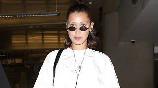 Bella Hadid Strides Through TSA In White