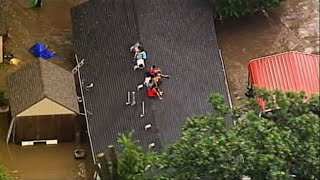 Raw: Kansas City Floods Force Family Onto Roof