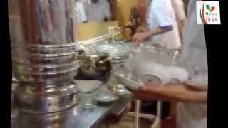 Iranian man serves tea in a tea-house in Iran