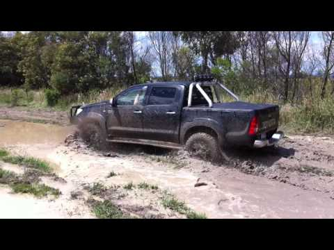 Toyota Hilux going through Mud, 4x4