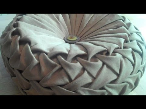 Canadian smocking capitone round cushion by Debbie Shore. Matrix design.