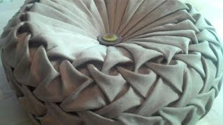 Canadian smocking/capitone round cushion by Debbie Shore. Matrix design.