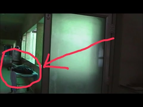 GHOST CAUGHT ON CAMERA IN A OLD HOSPITAL BUILDING