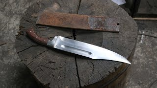 Making a Bowie knife from a semi truck leaf spring.
