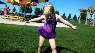 Little girl showing off her dance moves..