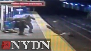 Man, woman use Taser to steal man's bag, knocking him onto tracks