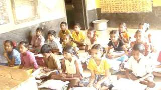A severely Disabled Bro  Asi's Teaching a song lesson Telugu Text to the 4th class Students inG Pangidigudem M P Elementary School