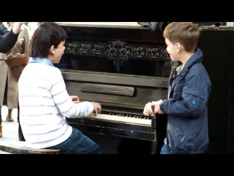 Piano prodigy kid performing on Session street in Lviv