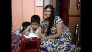 A BEAUTIFUL YOUNG SINGER teach her son with her OPEN BLACK HAIR & SWEET SMILE