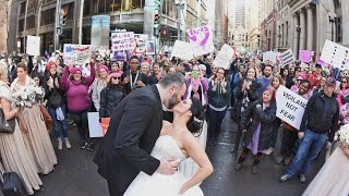 Photographer Snaps Incredible Wedding Photo Of Couple In Women's March