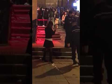 Woman Pissing in Hong Kong Public Area