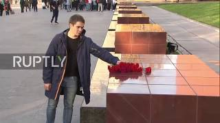 Russia: Muscovites pay respects at Kerch memorial following deadly college shooting