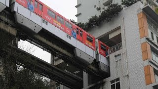 Train goes THROUGH a block of residential building in China's mountain city Chongqing