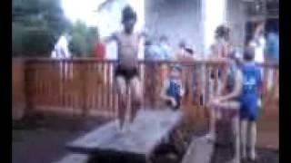 little boy dances in a speedo