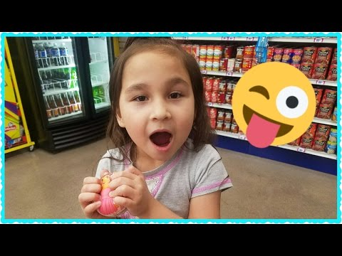 Looking for glue and squishies at the dollar store.