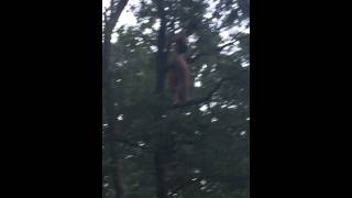 Naked guy in tree raging to Black Tiger Sex Machine at Wakarusa 2015