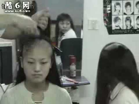 Two girls shave their long hair to bald together