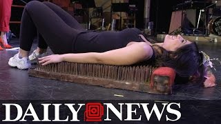 Daily Newser learns to use whip, lay on bed of nails