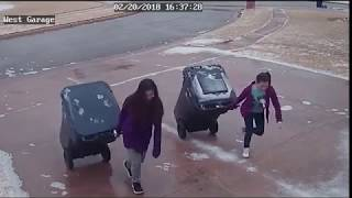 Slipping and sliding girls struggle to make it up icy driveway