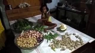 Little village girl selling vegetables