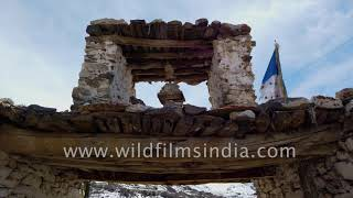 Himalayan Buddhist altar made of stone and wood, Buddhist prayers engraved on mane stones