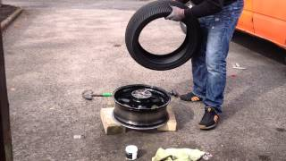 Motorbike tyre change by hand