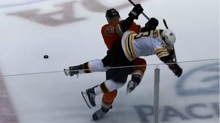 Manson lines up Marchand and delivers huge open-ice hit