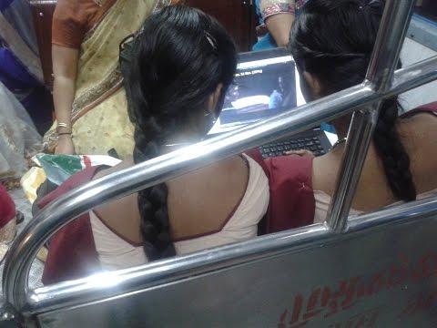 Two School Girls Watching Movie in Train