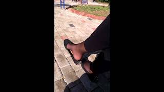 Pantyhose fetish: Foot and shoe play / dangling in park square
