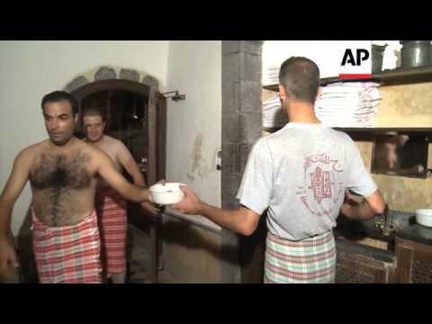 Men enjoy bathing at ancient Damascus hammam - 2014