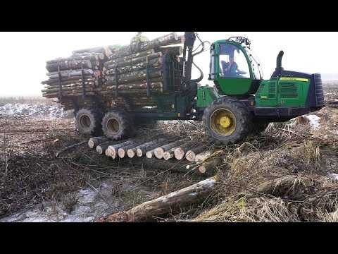 Logging with John Deere 1110E skilled operator