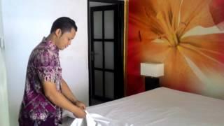 Making bed room hotel. Room boy di bali